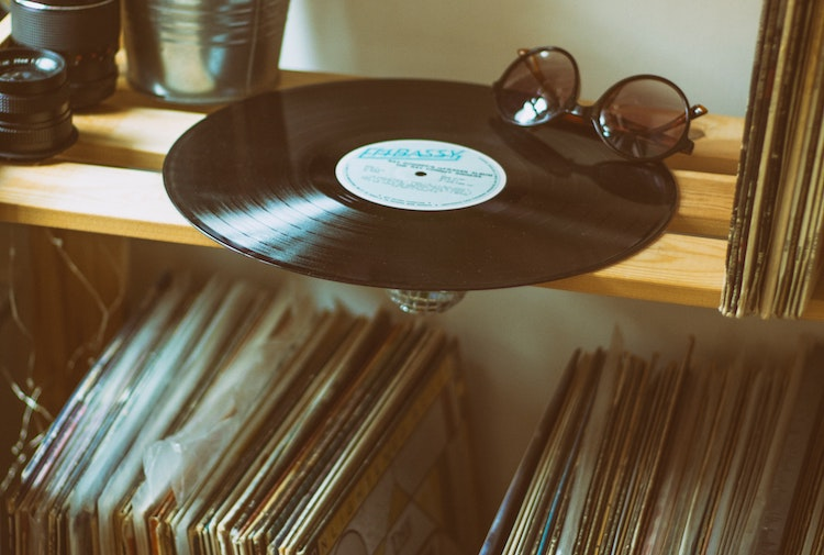 Vinyl record on shelf with record collection